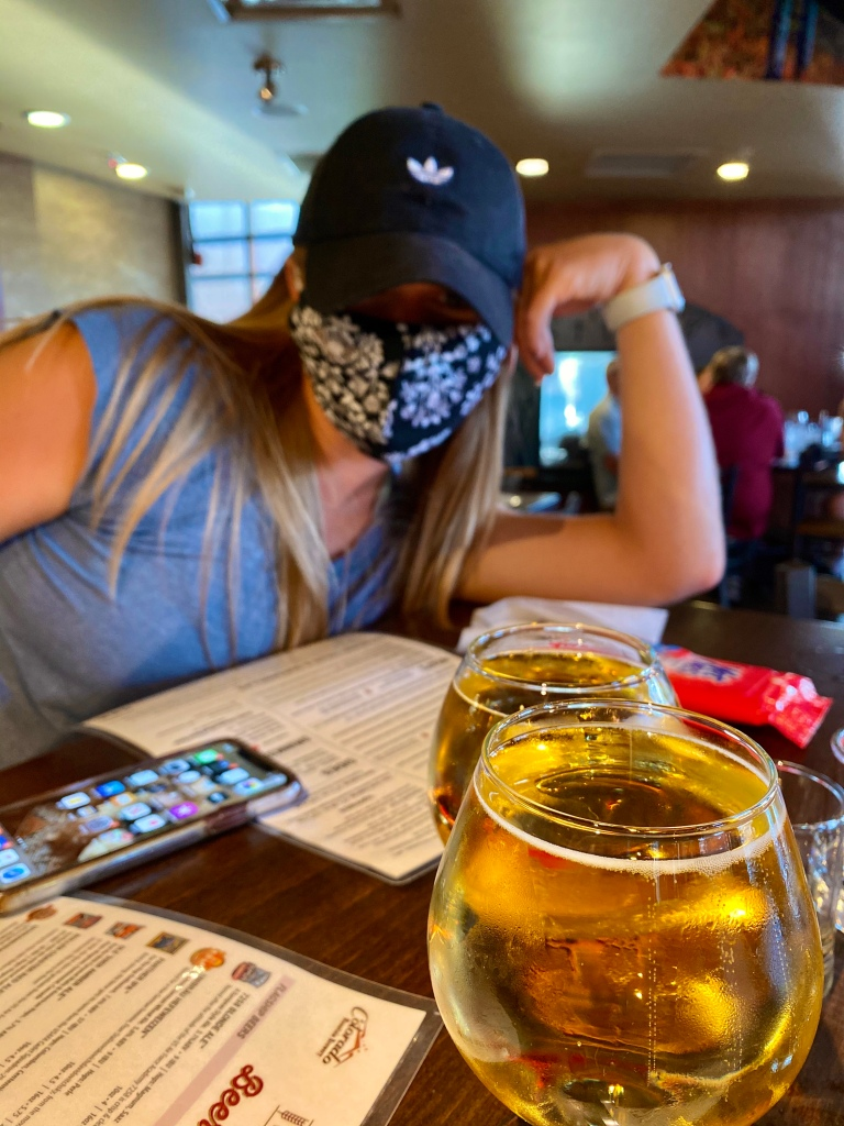 Colorado Mountain Brewery with two apple ciders on tap and face masks.