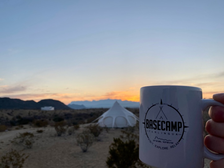 basecamp terlingua mug in front of the chisos mountains at sunrise